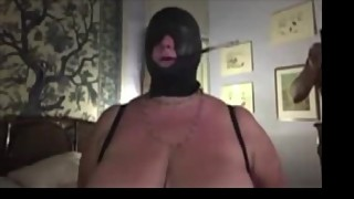 Augusta- Slut wife hooded and smoking with long holder